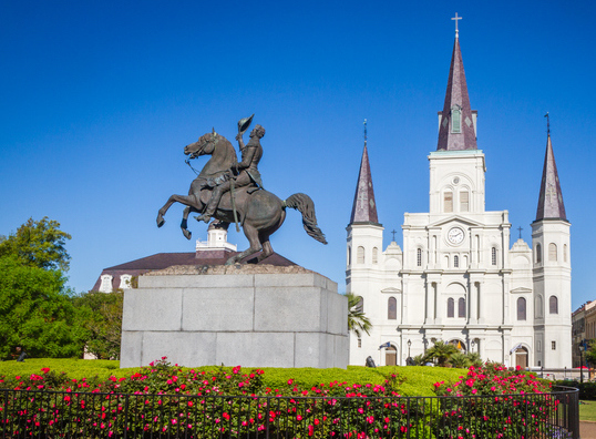 jackson square new orleans with saint louis cathedral in background on bright sunny day