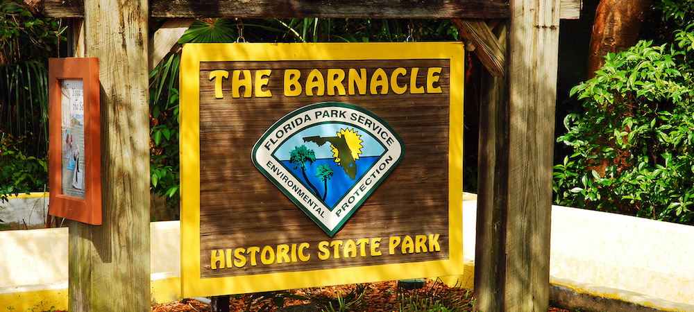 sign at the entrance to barnacle historic state park in miami florida
