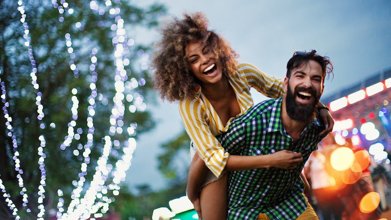 couple at music festival excited